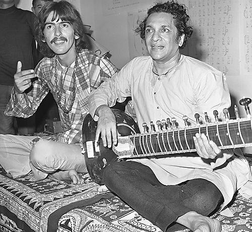 George Harrison studying the sitar with Ravi Shankar..