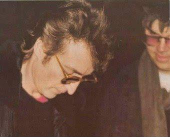 John Lennon , signing autograph right before his death