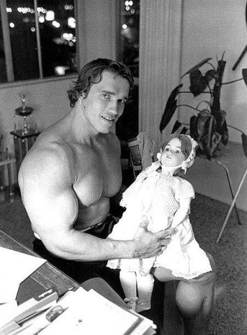 Arnold-Schwarzenegger-with-a-baby-doll