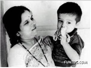 Childhood-Picture-of-Rahul-Dravid-eating-banana-in-his-mother-lap