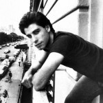 John-Travolta-leaning-from-balcony