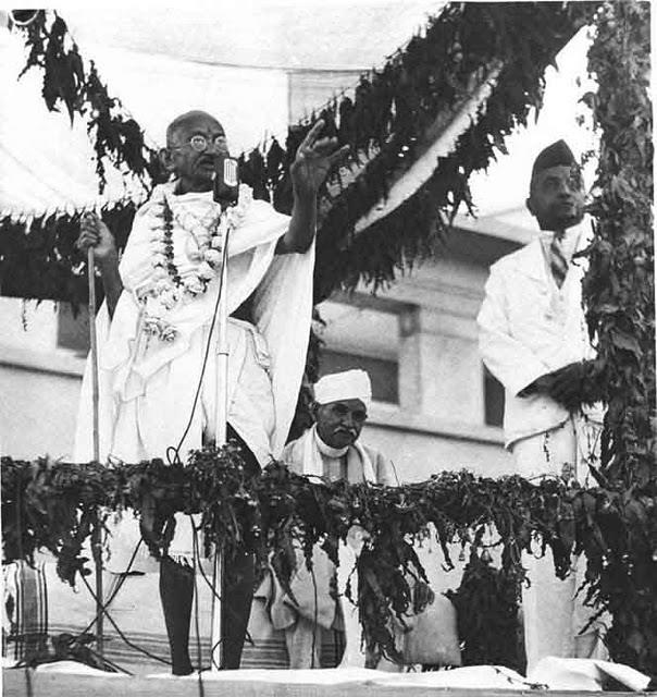 Mahatma-Gandhi-performing-the-opening-ceremony-of-Kamla-Nehru-Hospital-in-Allahabad-in-1941.-Pandit-Mahan-Mohan-Malavaya-is-Seated-next-to-him-and-Dr.-Jivaraj-Mehta-is-seen-standing-on-the-extreme-right