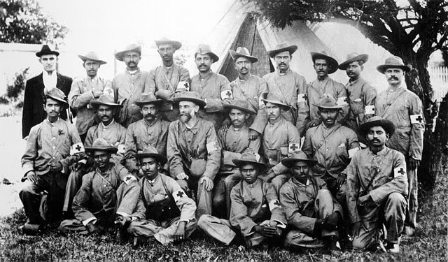 Mahatma-Gandhi-with-the-stretcher-bearers-of-the-Indian-Ambulance-Corps-during-the-Boer-War-South-Africa-Between-1899-1900