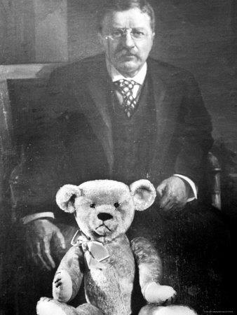 President Theodore(Teddy) Roosevelt with his famous Teddy's bear in 1902. This picture marks the creation of the ever so cute Teddy bear.....