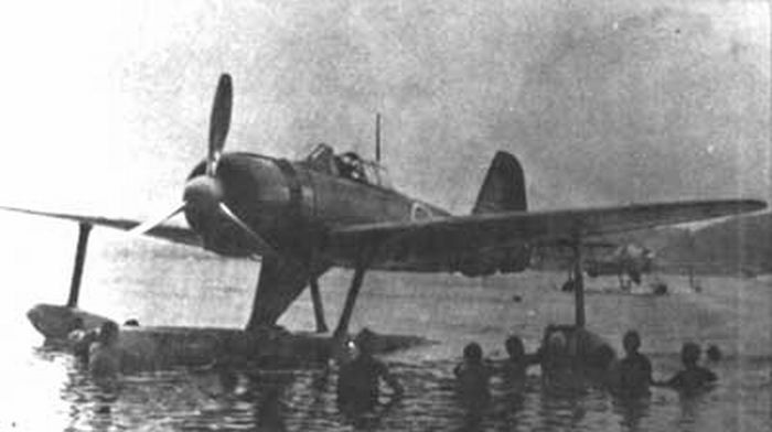 soldier-try-to-start-engine-of-fighter-plane-a6m2n-in-world-war-2