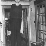 robert-wadlow-standing-in-front-of-short-door