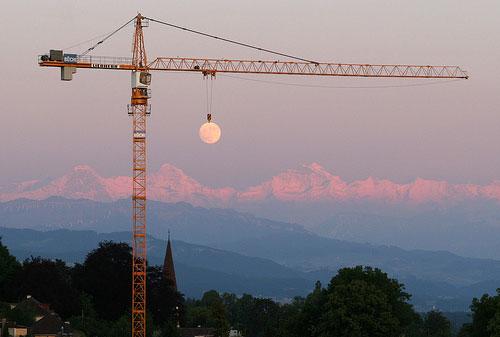 crane-lifts-the-sun