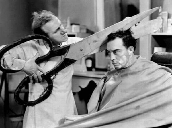 hair-cut-with-a-big-scissor.