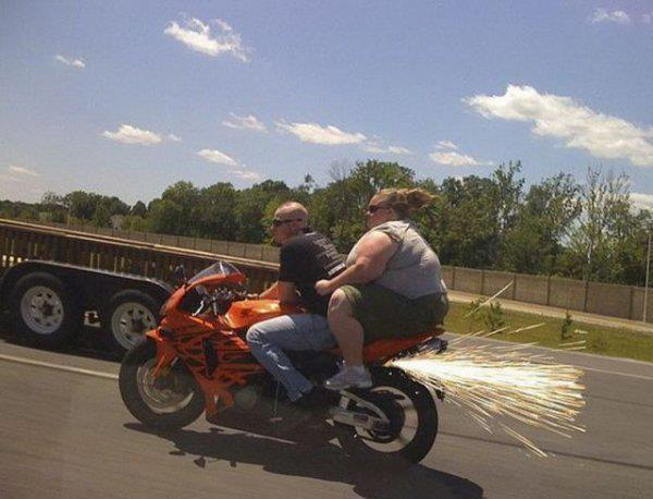 heavy-woman-on-back-of-motorcycle