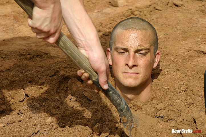 Bear-Grylls-under-soil-to-minimize-water-loss