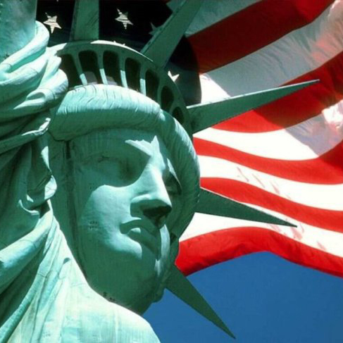 USA-flag-behind-Statue-of-Liberty