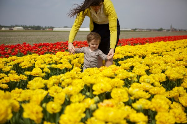 cute-baby-walking-with-mother-in-tulip-field