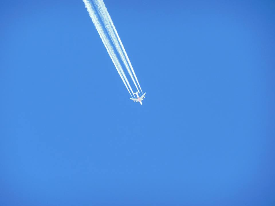aeroplane-flying-over-blue-sky
